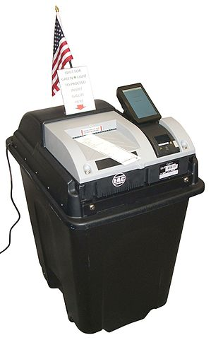 A Unisyn Voting Solutions precinct-count OpenElect Voting Optical Scan (OVO) ballot scanner, ready to scan a ballot marked by an OpenElect Voting Interface (OVI) ballot marking device.