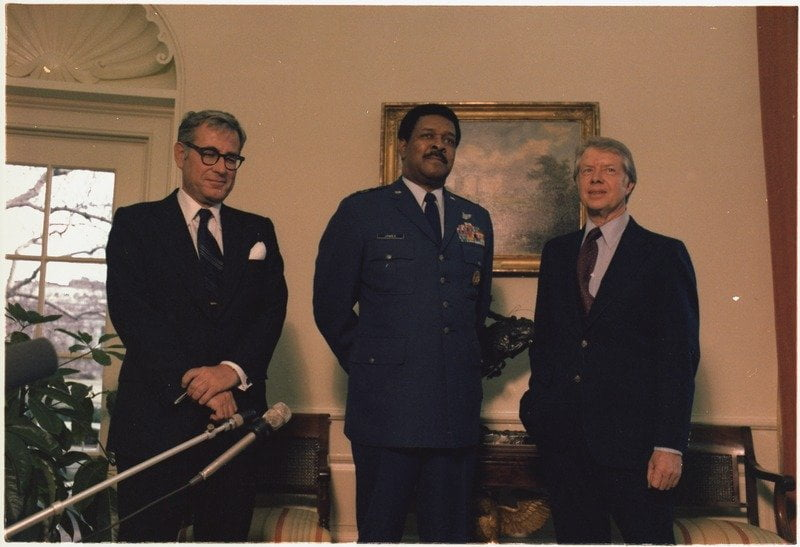 "Secretary of Defense Harold Brown and General Daniel ""Chappie"" James visit with Jimmy Carter. - NARA"